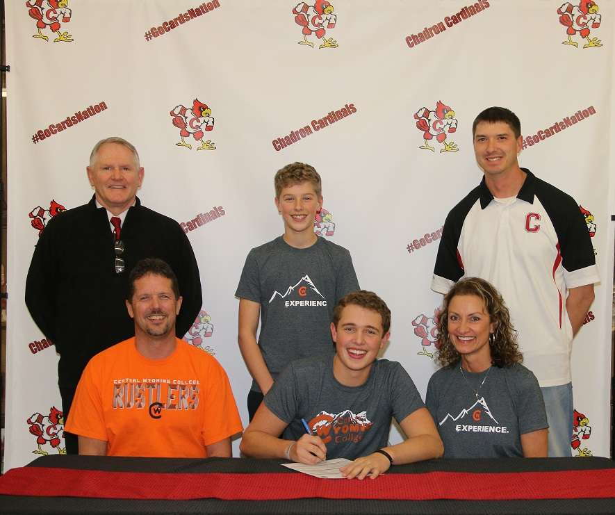 Trevor Berry signs his Letter of Intent. With him are his parents, LeeVern and Tricia. In the back, from left, are Chadron High Athletic Director Andy Pope; his brother, Broc; and his high school golf coach, C.J. Bach.  Photo Courtesy: Con Marshall