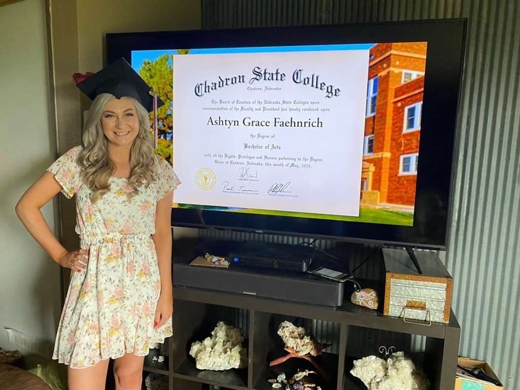 Chadron State College graduate Ashtyn Feahnrich poses with a screen shot of her diploma during CSC's first virtual commencement ceremony May 9, 2020. (Courtesy photo)