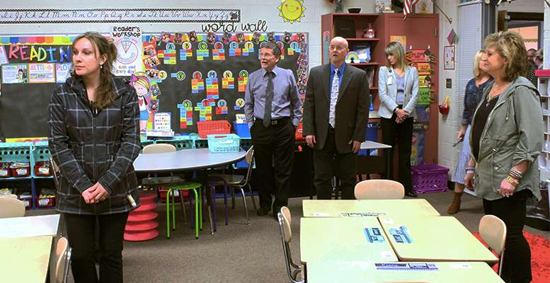School board members and guests toured O'Loughlin Elementary School during its meeting Monday.