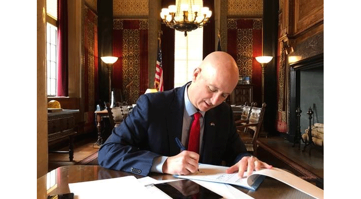 Gov. Ricketts signs LB 1198 into law, providing emergency funds to fight coronavirus.