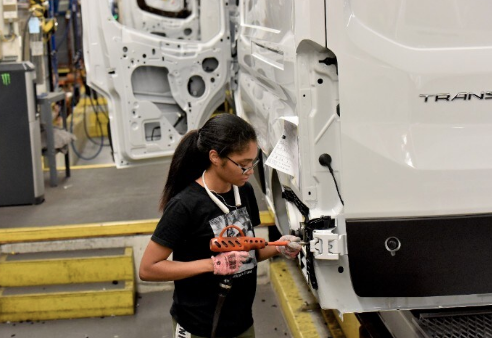 Kami Hunt, Ford Motor Company employee, assembles the Ford Transit at Kansas City Assembly Plant in August of 2019. Photo Courtesy Ford Motor Company