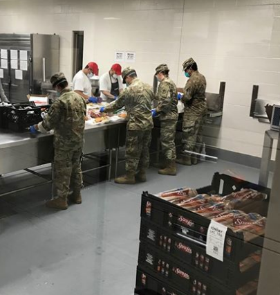 Kansas National Guard Soldiers and Airmen are assisting at Lansing Correctional Facility on May 5 supplementing kitchen staff by preparing sack lunches for distribution to residents throughout the facility- photo courtesy Kansas National Guard