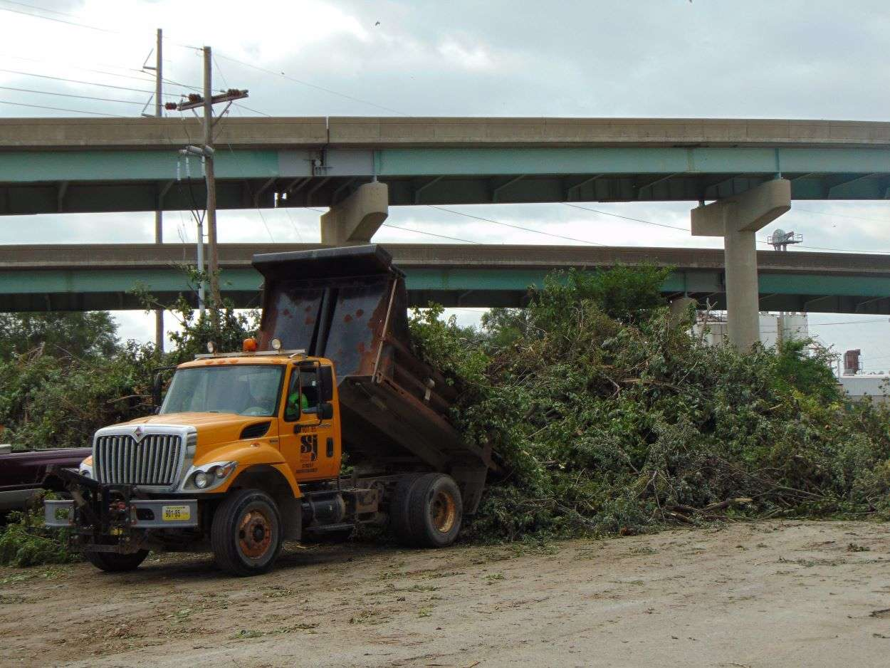A city truck dumps debris at the new drop-off site at the old Riverfront Park/Photo by Brent Martin