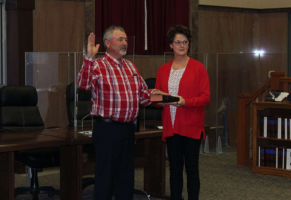 Ellis County Commissioner for the Third District Neal Younger is sworn in for his first term as a commissioner Monday. Younger replaces Dustin Roths on the commission.