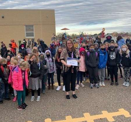 Wilson Elementary School Principal Anita Scheve with some of her students at Wilson Monday morning after receiving her Principal of the Year Award. Courtesy photo